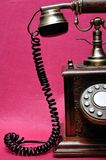An old telephone. Isolated on a pink background royalty free stock photo