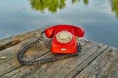 Old telephone in nature Stock Photos
