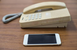 Old telephone and mobile,concepts compare new and old technologi. Es Royalty Free Stock Photos