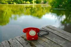 Old telephone in nature Royalty Free Stock Image