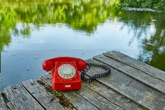 Old telephone in nature Royalty Free Stock Photos