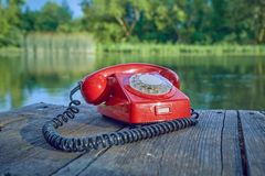 Old telephone in nature Royalty Free Stock Photo