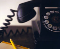 Old telephone and note pad Royalty Free Stock Photos