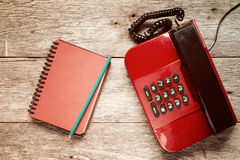 Old telephone and personal organizer Stock Images