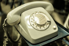 Old telephone, phone with dial plate - retro objects. Old telephone, phone with dial plate - plastic phone Stock Photos