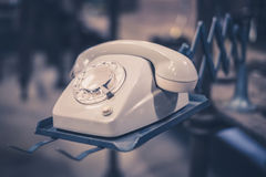 Old telephone, phone with dial plate - retro objects. Old telephone, phone with dial plate - plastic phone Royalty Free Stock Photography