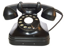 Old telephone. An old phone in a white background royalty free stock images