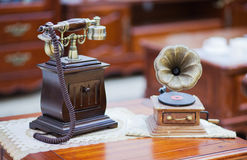 The old telephone and the phonograph. Modern families are mostly adopt the modern household appliances, however, in the modern home furnishing products, old Stock Images