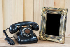 Old telephone and Picture frame Royalty Free Stock Images