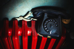 Old Telephone on Red Radiator Royalty Free Stock Images