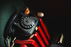 Old Telephone on Red Radiator Royalty Free Stock Image