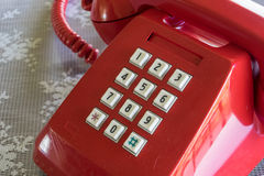 Old telephone. Red old telephone and white key pad stock photos