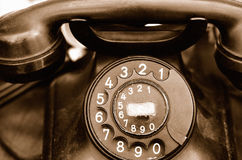 Old telephone. Old rotary telephone close-up. Sepia with grain added Royalty Free Stock Photos