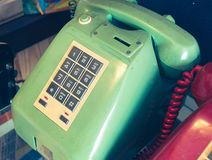 An old telephone with rotary dial. On glass cabinet Royalty Free Stock Images