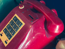 An old telephone with rotary dial. On glass cabinet Royalty Free Stock Photography