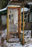 Old telephone in the village. Old telephone set in a village in Russia in Siberia Stock Photos