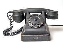 Old telephone set on a white background. Old black telephone set on a white background (isolation Royalty Free Stock Photos