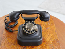 Old telephone on table Stock Photo