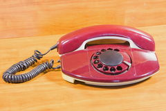 Old telephone on a table Stock Photography