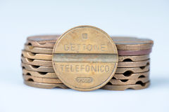 Old telephone tokens out of use in Italy Royalty Free Stock Photo