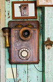 An old telephone  vintage. On old wall Royalty Free Stock Images