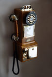 Old telephone on wall. Old obsolete retro telephone on wall Royalty Free Stock Photo