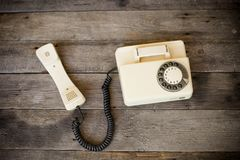 Old telephone on wood. Background Stock Photo