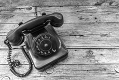 Old telephone on wooden background Stock Photos