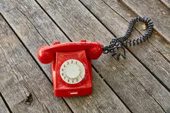 Old telephone on wooden boards Royalty Free Stock Image