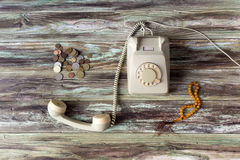 An old telephone on a wooden table royalty free stock image