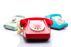 Old telephones on white Stock Image