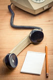 Old telepnone handset with notebook Stock Images