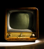 Old Television. Close-up of an old dusty legacy soviet television set, full of dust and sitting in strong window light Royalty Free Stock Photo