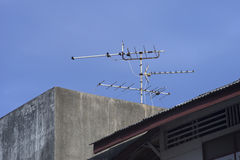 Old television antenna on a roof to receive signals from the transmitter. Royalty Free Stock Photos