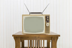 Old Television with Antenna on Wood Table Stock Photography