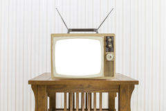 Old Television with Antenna on Wood Table with Cut Out Screen Royalty Free Stock Image