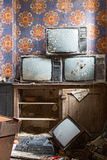 Old television. Old antique television broken grunge televisions broken en full of dust end of TV Stock Image