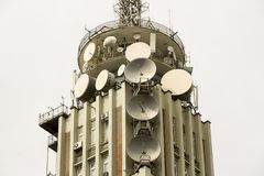 Old television broadcast tower. With satellite dishes and communication antennas Royalty Free Stock Images
