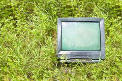 Old television CRT Cathode ray tube abandoned in nature - concept image with copy space.  royalty free stock photography
