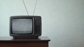 Analog TV with signal bad interference. An old television from the 70`s turned on with only static appearing on the screen stock footage