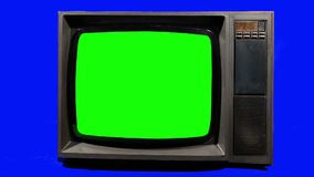 Old Television,  Turning Channels. Green Screen. Stock Images