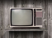 Old television on wood shelf Royalty Free Stock Image