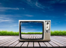Old television on wooden terrace Stock Photo