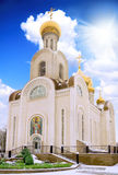 Old Temple with blue sky and sun. Rostov-on-don royalty free stock photo