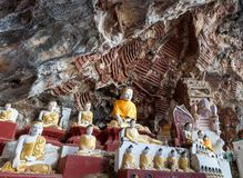 Old temple with buddha statues in Kaw Goon cave. royalty free stock images