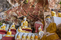 Sacred Kaw Goon cave near Hpa-An in Myanmar Burma. Old temple with Buddhas statues and religious carving on limestone rock in sacred Kaw Goon cave near Hpa-An in royalty free stock image