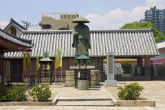 Old temple building with a statute in front of it Royalty Free Stock Photography