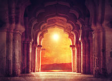 Old temple in India. Old ruined arch in ancient temple at sunset in India Royalty Free Stock Photography