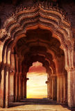 Old temple in India. Old ruined arch in ancient temple at sunset in India Stock Image