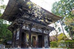 Old temple with nice sakura flower Stock Photo